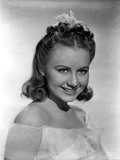 Ann Gillis smiling and wearing an Off-Shoulder Top Portrait