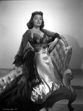Donna Reed on a Dress Kneeling on Couch in Black and White
