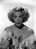 Betty Hutton on an Off Shoulder Dress and Holding a Paper
