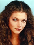 Amy Irving Showing a Cute Smile in a Close Up Portrait