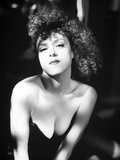 Bernadette Peters Posed in Black Column Dress Leaning Forward