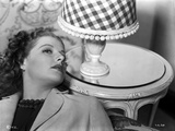 Ann Sheridan Leaning on the Chair Near a Lamp Shade