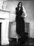 Deborah Raffin Leaning on a Drawer wearing Black Vest and Black Pants