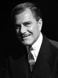 Ben Lyons Portrait smiling in Black Suit and Black Ties