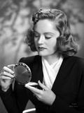 Alexis Smith Looking in a Small Mirror wearing Black Suit