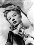 Betty Hutton Lying on a Couch with Flower