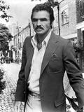 Burt Reynolds wearing a Black Suit