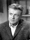Brian Keith Posed in Black Suit With Black and White Background