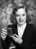 Alexis Smith Putting a Make Up While smiling