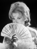 Arlene Dahl Covering Her Mouth with A Fan