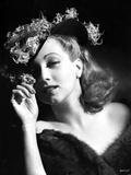Ann Sothern wearing a Hat and A Furry Dress