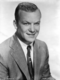Aldo Ray Posed in Suit With White Background