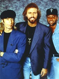 Bee Gees Band Members in Blue Suit and Denim Jacket with Black Flat Cap and Flat Top Cap