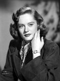 Alexis Smith Posed in Black Coat wearing a Wrist Watch
