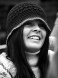 Ali MacGraw smiling and wearing a Bonnet
