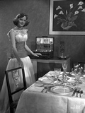 Alexis Smith standing Beside the Dining Table