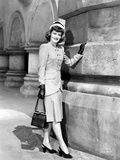 Alexis Smith standing and Holding a Hand Bag