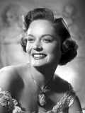 Alexis Smith smiling and wearing a Necklace with Big Pendant