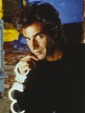 David Copperfield Holding Handcuffs in Black Shirt