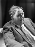 Charles Laughton sitting in Classic