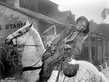 Cat Ballou Man Riding a Horse in Cowboy Outfit
