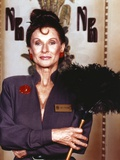 Cloris Leachman Posed in Blue Long Sleeve while Holding a Feather Duster