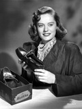 Alexis Smith Holding a Shoe while smiling in a Classic Portrait
