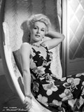 Eva Gabor on Printed Dress sitting