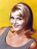 Carol Lynley in a Stripe Tank Top on a Yellow Background