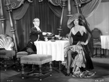 Bebe Daniels Having a Dinner with a Man in Black Strap Dress with Hands Laid on the Waist