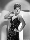 Claire Trevor Looking Away in Black Dress with Hand on Hips