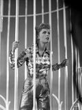 Debbie Reynolds wearing in Checkered Top Behind Bars