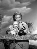 Greer Garson Posed wearing Silk Top Holding a Camera and a Dog