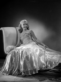 Gloria DeHaven Leaning On A Couch in Gown in Black and White