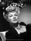 Claire Trevor Lying in Black Dress with Necklace
