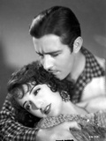 Bebe Daniels Lying on the Man's Arms in Knitted Dress