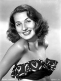 Brenda Marshall on a Printed Tube Top smiling Portrait