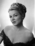 Claire Trevor Posed in Black Dress with Earrings