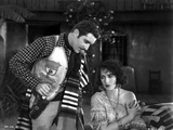 Bebe Daniels Listening to the Man in Polka Dot Sleeve Shirt while Seated in Knitted Dress