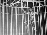 Debbie Reynolds Swinging in Plaid Sleeves with Leather Pants