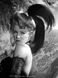 Claire Trevor Posed Sideways in Black Dress with Feather Headband