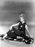 Deborah Kerr sitting on a Floor and Reclining