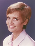 Florence Henderson with Short Hair  smiling in Pink Polo Shirt