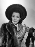 Frances Dee smiling in Fur Coat in A Portrait in Black and White