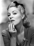 Claire Trevor Putting lipstick in Dress with Ring