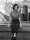 Debbie Reynolds wearing Plaid Top and Black Plants