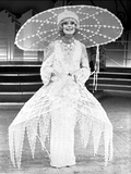 Carol Channing wearing an Embroidered Long Dress with Big Hat
