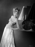 Gloria DeHaven Leaning On A Table in Gown in Black and White