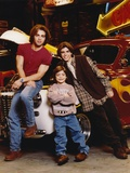 Brotherly Love Cast Three People Posed with Vehicle