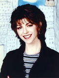 Caroline In The City smiling in Black Coat Portrait